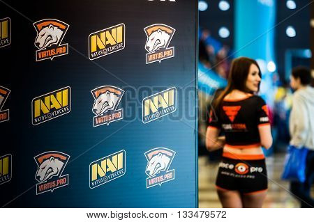 MOSCOW, RUSSIA - MAY 13 2016: EPICENTER MOSCOW Dota 2 cybersport event. Beautiful promo girls over virtus pro and natus vincere banner