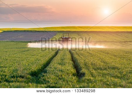 Sunset Above Spraying Machine
