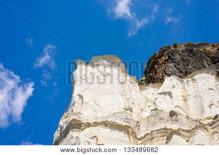 Layered ash deposits rock formations formed by volcanic activity at Melos island Greece.