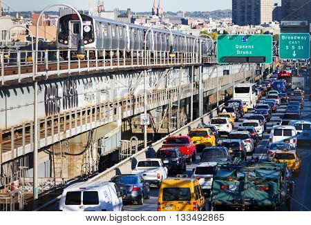 NEW YORK CITY - OCTOBER 15: Heavy traffic back ups on the Williamsburg Bridge while a subway train passes by during rush hour in New York City on October 15 2015. The bridge connects Lower Manhattan with the borough of Brooklyn.