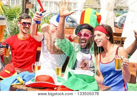 Sport supporters watching football game on tv screen at urban bar outdoor - Multiracial  fans of soccer cheering and fun moment together