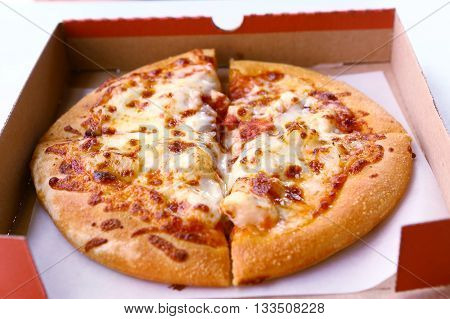 Pizza in cardboard box close up photo