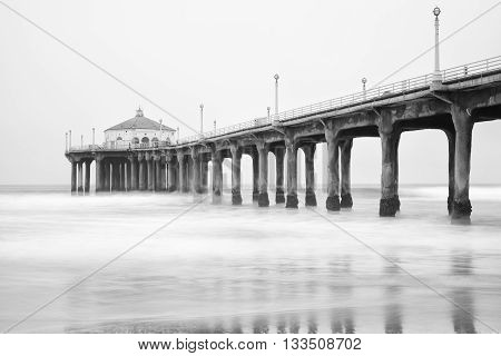 Black and white photo of Manhattan beach pier California.