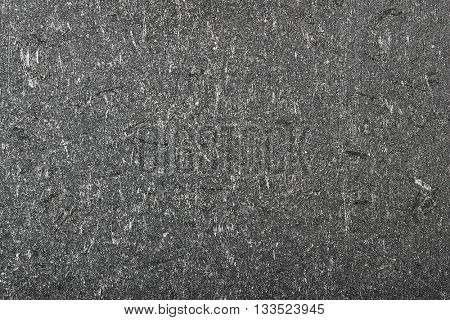 texture of black cast iron with scratches