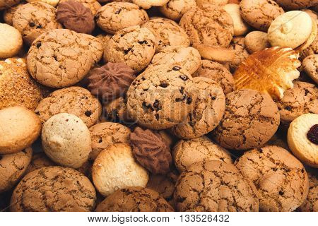 Cookies background. Sweet chocolate chips biscuits, shortbread and cookies with jam texture background.