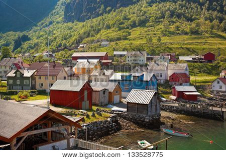 Beautiful Fishing Village Undredal Against Mountain Near The Flam In Norway