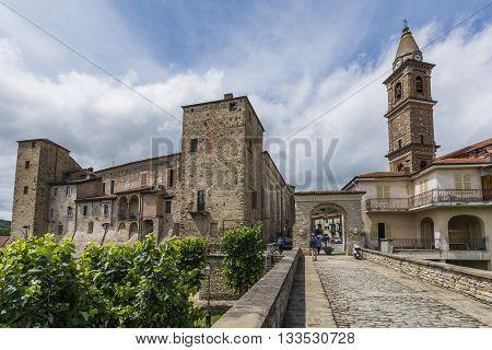 Monastero Bormida Italy - May 29 2016: Bridge houses and Church of Monastero Bormida in Piedmont Italy