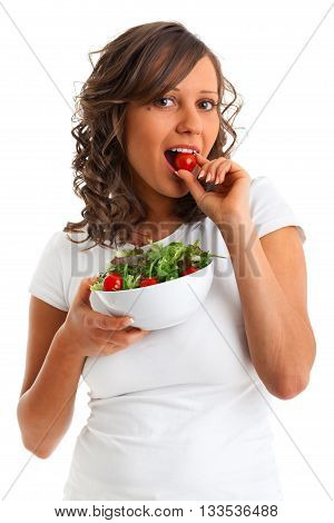 Young woman eating healthy salad with cheery tomatoes isolated on white background