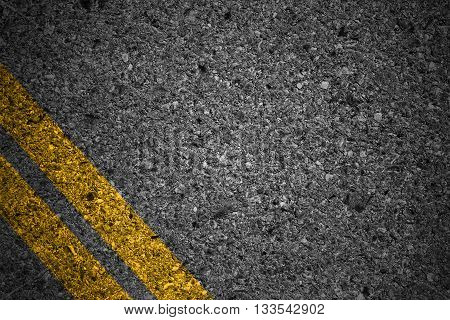 Highway surface with yellow lines. Asphalt background
