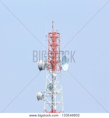 communication antenna tower and satellite dishes and a red and white tower