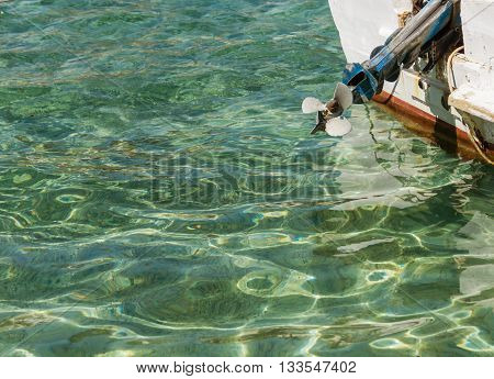 Motor boat on the sea background screw and sand