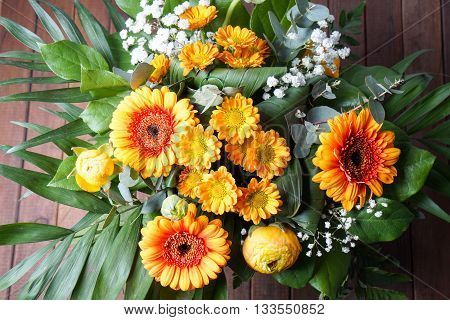 bouquet of orange flowers perfect for Mothers day or birthdays. Peonies Bridal Viels green leaves and daisies