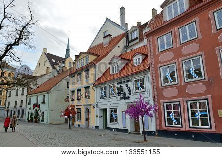 RIGA LATVIA - MARCH 10: Houses in the Old Town of Riga on March 10 2015 in Riga Latvia. Old Town is the most popular touristic place in Riga.