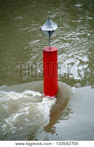 red tag on a fast flowing river