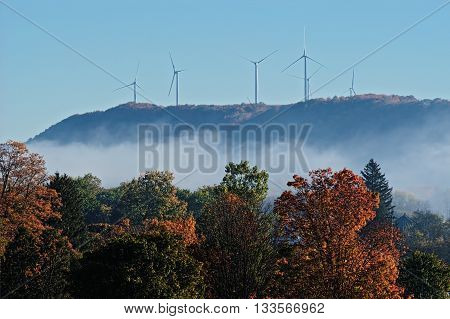 Group of Wind Turbines on the Hills in Autumn