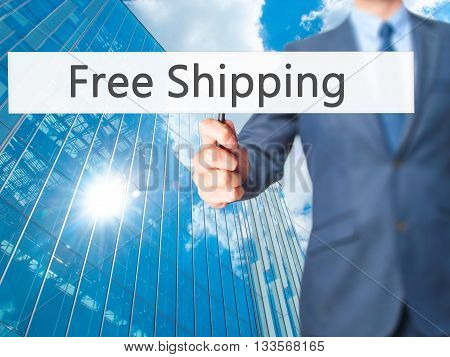 Free Shipping  - Businessman Hand Holding Sign