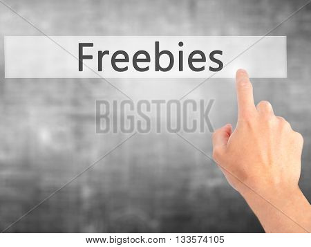 Freebies - Hand Pressing A Button On Blurred Background Concept On Visual Screen.