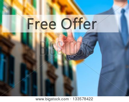 Free Offer - Businessman Hand Pressing Button On Touch Screen Interface.