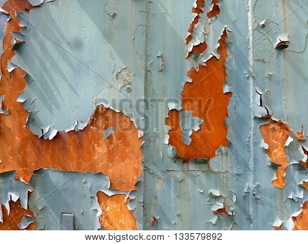 Rusty surface of a piece of steel with a cracked, peeled, dirty paint