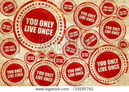 you only live once, red stamp on a grunge paper texture