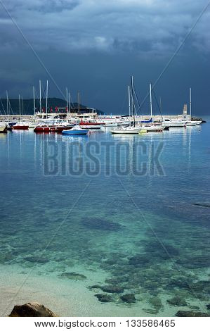 Montenegro, Herceg Novi - 17.05.2016: View in stormy weather on a boat in the port. City port in the district Square in city of Herceg Novi.