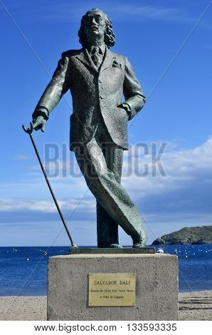 CADAQUES, SPAIN - MAY 20: Detail of a bronze life-size statue to famous Salvador Dali on May 20, 2015 in Cadaques, Spain. This small town in the Costa Brava holds the House-Museum of the artist