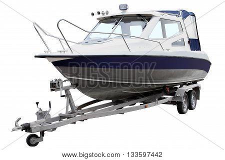 Blue cabin boat loaded on the trailer for transportation.