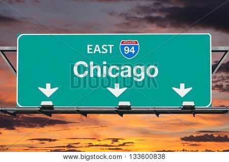 Chicago Interstate 94 east highway sign with sunrise sky.