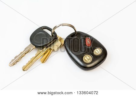 Vehicle keys on standard black FOB with alarm and lock buttons