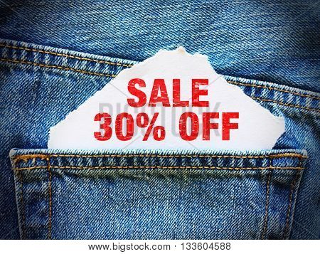 30% off on white paper in the pocket of blue denim jeans