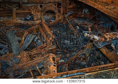 Inside of a rusty burnt out & destroyed car