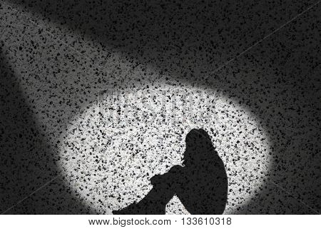 Shadow of a Young Woman against the Background of a Stone Wall.