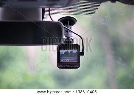 Dash camera in car installed on the window