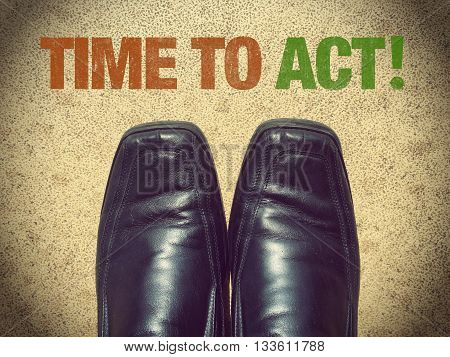 Black men shoes with words Time to act!