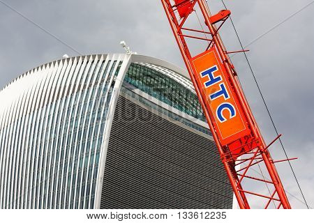 LONDON, 8 AUG 2015. Editorial Photo of HTC Plant Crane & 'Walkie Talkie' Building. Over 260 tall buildings are now planned for the UK capital city in an attempt to deal with the London housing crisis.