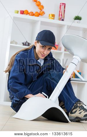 female worker fixing a chair