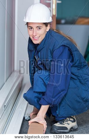 Crouched woman holding cardbord box