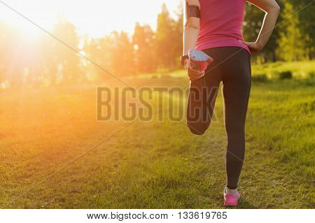 Running stretching - runner wearing smartwatch. Cardio and  fitness.