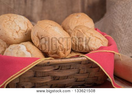 Dinner rolls in a basket with red cloth