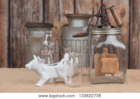 Vintage butter churn, old milk bottles and cow creamer