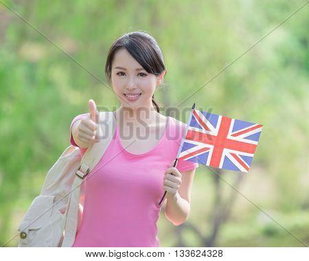 Happy College Student girl hold British flag and show thumb up with nature white background asian