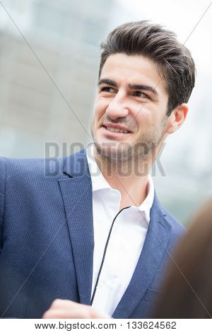 Business man smile with business office building background caucasian shot in Hong Kong