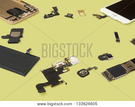 Smart phone components isolate on Yellow background with copy space