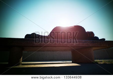 Drank Adult Man Rests On Stony  Bench In Park, Sharp Sun Rays