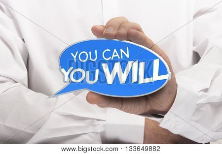 Hand holding a bubble speech where it is written you can and you will. Motivational concept for determination and willpower. Composite image between a photography and a 3D sign.