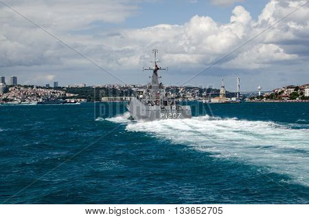 ISTANBUL TURKEY - JUNE 8 2016: The Navy patrol ship Tekirdağ sailing along the Bosphorus and the landmark Maiden's Tower in Uskudar. The Turkish ship is escorting the larger Russian frigate Admiral Grigorovich which can be seen to the left