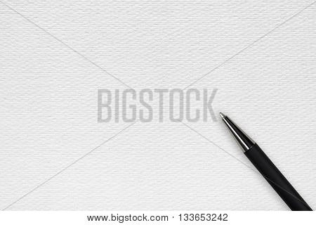 White papper background with black ball pen and text space