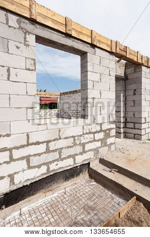 Building house from aerated concrete building blocks.