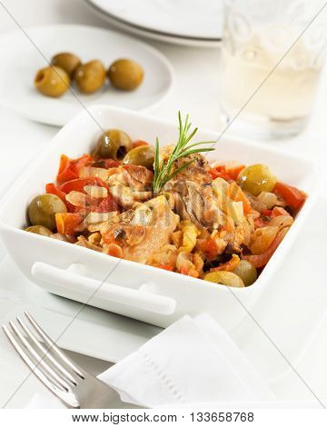 Chicken with tomato bell pepper onion and olives