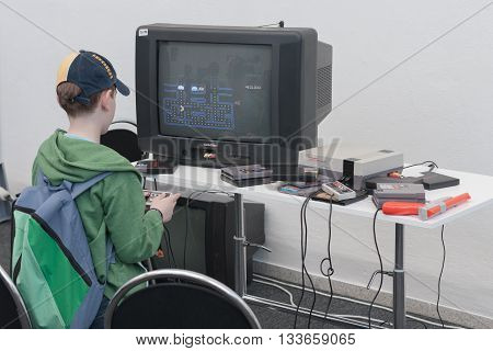 Boy Plays Gaming Console With Television At Animefest